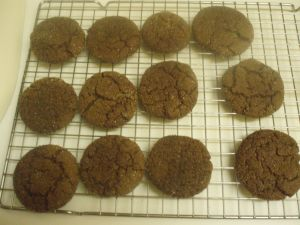 """A cooling tray of molasses biscuits"""