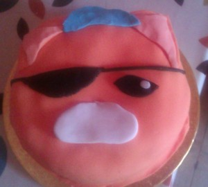 """An orange cake with an eye patch"""
